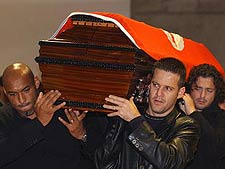 Stunned Benfica players carry Feher's coffin into the stadium.