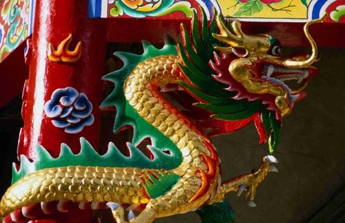 Golden dragons protect the main entrances to all Chinese temples, in Bangkok's Chinatown