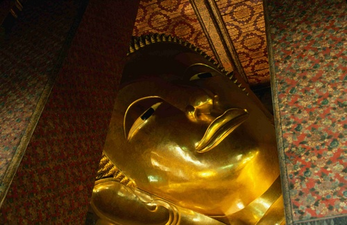 Detail of the face of the largest reclining Buddha in Thailand