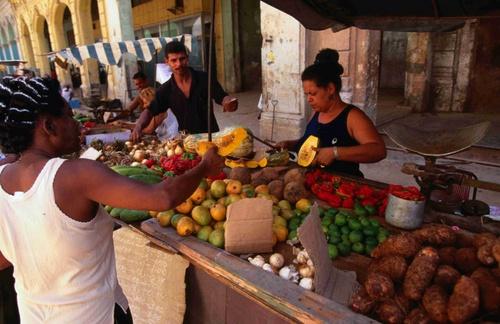 Vegetable market at train station.