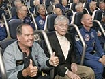 Nearly 40 former astronauts prepare to take a ride on the new Space Shuttle Experience launch simulator during grand opening ceremonies at the Kennedy Space Center Visitor Complex in Cape Canaveral, Fla., Friday, May 25, 2007. (AP)