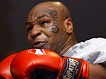 Former heavyweight boxing champion Mike Tyson spars during a training exhibition in Las Vegas in this Aug. 30, 2006 file photo. (AP)