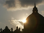 Sun setting on St Peter's Basilica in Vatican City, 2005 (Menahem Kahana/AFP/Getty Images)