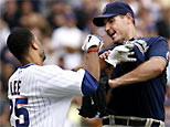 Derrek Lee fights with pitcher Chris Young (AP Photo/Nam Y. Huh)
