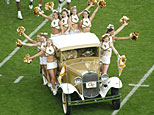 Georgia Tech Cheerleaders ride the Rambling Wreck - a 1930 Ford Cabriolet Sport Coupe (Doug Pensinger/Getty Images)