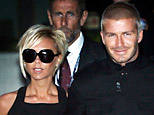 England soccer player David Beckham holding his wife's hand Victoria arrive at Los Angeles International Airport Thursday July 12,  2007. David Beckham is traveling to the United States where he has signed to play for Major League Soccer team Los Angeles Galaxy. (AP Photo/Kevork Djansezian)