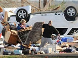 People searching through debris from a tornado (AP)