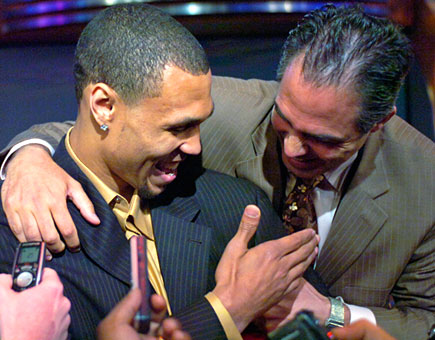 Happy as can be are the Portland duo of NBA Roy Brandon Roy and GM Kevin Pritchard.